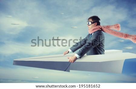 Businessman flying on paper plane #195181652