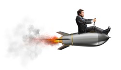 Businessman flying over a rocket. concept of company startup