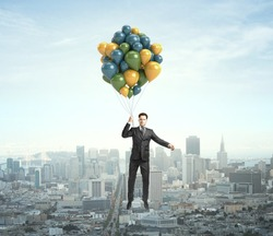 businessman flying with air balloons over the city