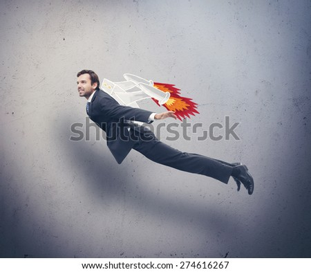 Shutterstock Businessman flying with rocket backpack