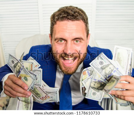 Businessman formal suit hold cash dollars hands. Che k out my profit this month. Earn money easy business tips. Man cheerful happy businessman with pile dollar banknotes. Profit and richness concept. Stock foto ©