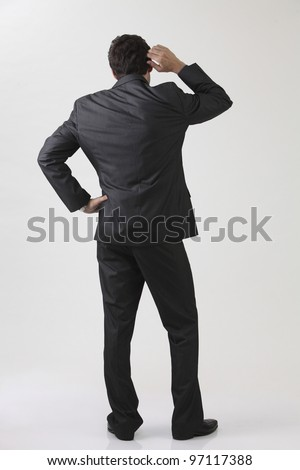 Businessman from behind,with doubt