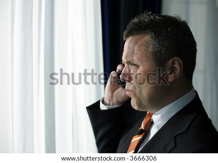 Businessman full of confidence talking on his blackberry closing a deal