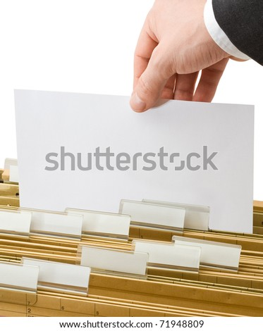 Businessman gets paper from row of office folders