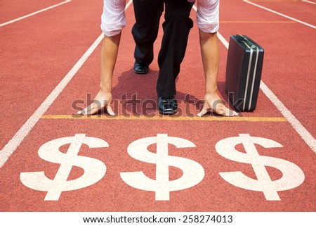 Shutterstock businessman getting ready for race on the track