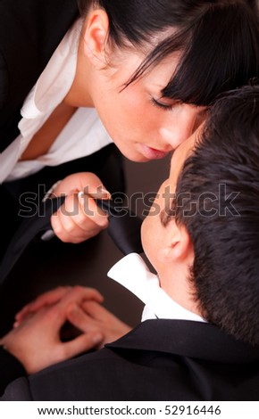 Businessman getting tie touched by passionate woman