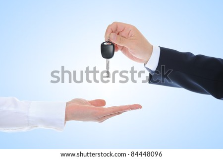 Businessman gives the keys to the car.