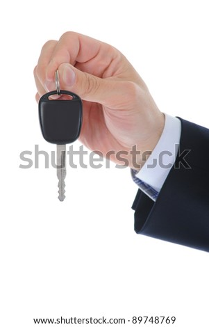 Businessman gives the keys to the car. Isolated on white