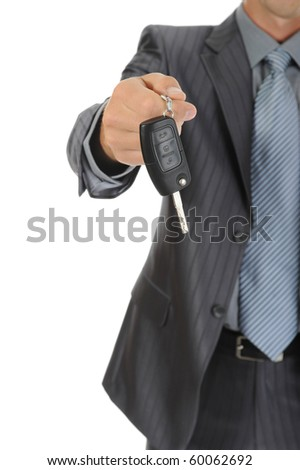Businessman gives the keys to the car. Isolated on white background - stock photo