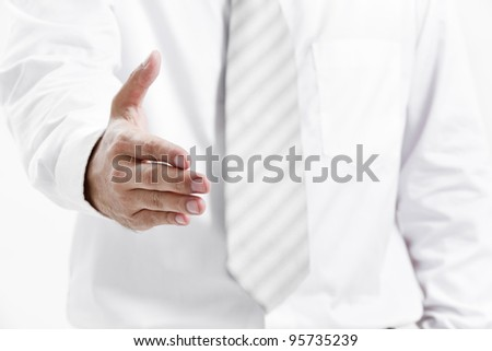 Businessman giving an hand for handshake to seal the deal
