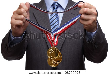 stock-photo-businessman-giving-gold-medal-prize-for-success-in-business-108722075.jpg