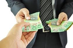 Businessman giving money - Australian Dollar Bills