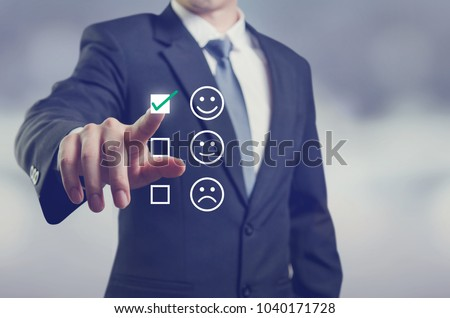 Businessman giving rating with happy icon, Customer satisfaction survey concept