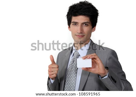 Businessman giving the thumb's up and holding a business card