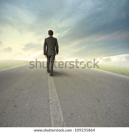 Businessman goes straight on his way - stock photo