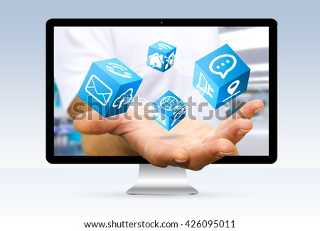 Businessman going out of a computer screen using modern digital cube interface '3D rendering'3D rendering #426095011