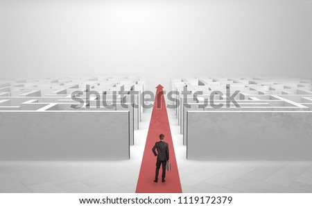 Businessman going straight ahead on a red carpet arrow between two maze #1119172379