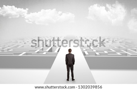 Businessman going straight ahead on a wide road between mazes #1302039856