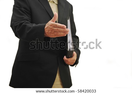 businessman greeting client with hand extended to shake hands, face not showing