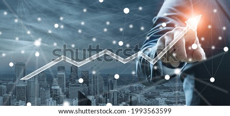Businessman Growth success, using finger touch a stock graph and chart background.