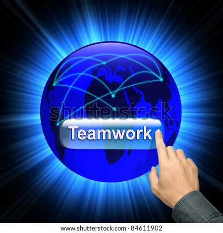 Businessman hand and word Teamwork - business concept