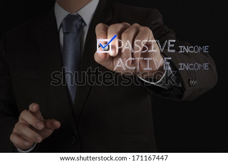 businessman hand checking  passive or active income as money concept