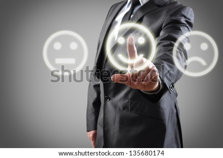 Businessman hand choosing smile on touch screen
