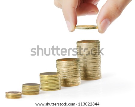 businessman hand coins in finger and row stacks them isolated on white