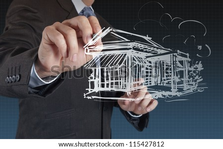 businessman hand draw house