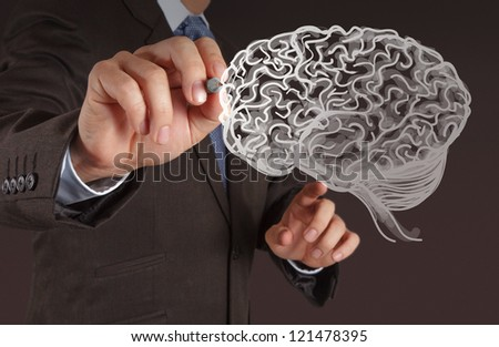Businessman hand drawing a brain