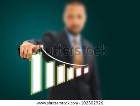 Businessman hand drawing a graph