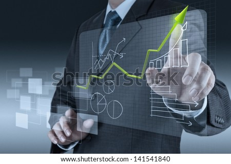 businessman hand drawing a pie chart and 3d graph