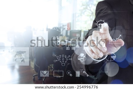 businessman hand drawing creative business strategy with light bulb as concept and bokeh exposure