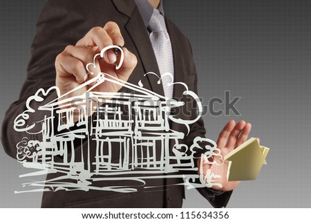 businessman hand drawing house in a whiteboard