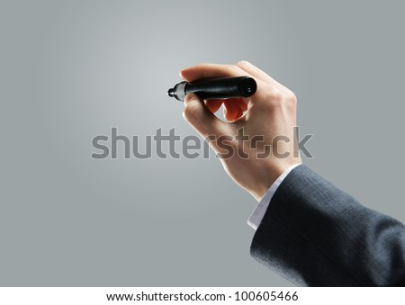 Businessman hand drawing in a blank whiteboard
