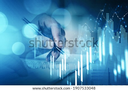 Businessman hand drawing virtual chart or collect stock market rates into notebook to make a forecast. Double exposure. The concept of successful investment decision