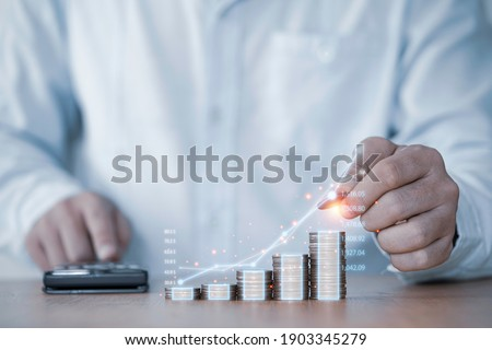 Businessman hand drawing virtual increasing graph with money coins stacking , Business investment profit and deposit dividend saving growth in 2021 concept. Photo stock ©