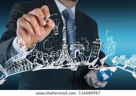 businessman hand draws dream travel around the world