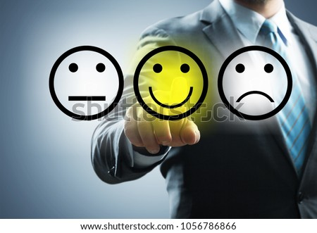 Businessman hand holding baner with emotion icons