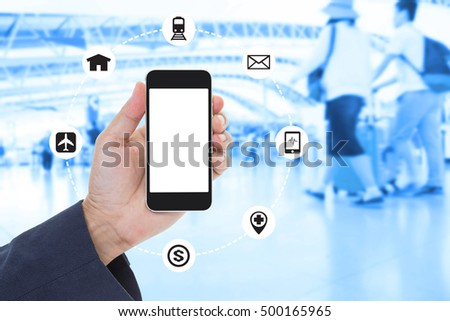 Businessman Hand holding blank screen mobile phone with blurred image of crowd