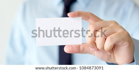 Businessman hand holding blank white business card with copy space for text, business mock up background concept  #1084873091
