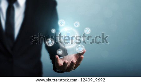 Businessman hand holding bubble plus sign means to offer positive thing (like benefits, personal development, social network)