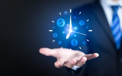 Businessman hand holding clock and money icon, Business time management and business time is money concepts