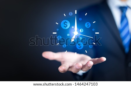 Businessman hand holding clock and money icon, Business time management and business time is money concepts Foto stock ©