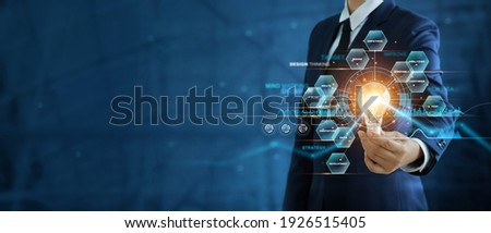 Businessman hand holding creative light bulb with marketing network icons on planning strategy, analysis solution and development, Modern business, Innovative of new ideas.