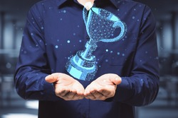 Businessman hand holding digital polygonal winner cup. Communication and winner concept. Close up.