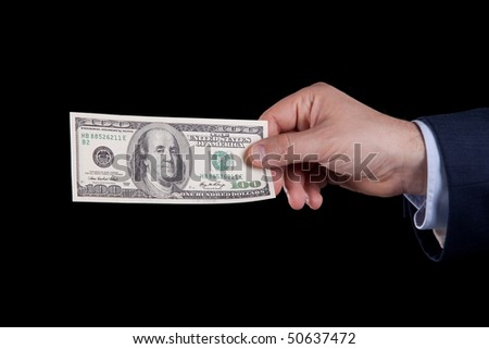 businessman hand holding one hundred dollar bill (isolated on black)