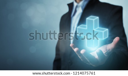 Businessman hand holding plus sign virtual means to offer positive thing (like benefits, personal development, social network)