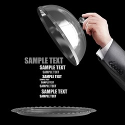 businessman hand holding silver platter or cloche with space to place object isolated on black background