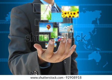 businessman hand holding streaming images virtual buttons